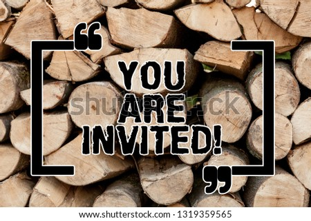 Text sign showing You Are Invited. Conceptual photo Receiving and invitation for an event Join us to celebrate Wooden background vintage wood wild message ideas intentions thoughts. #1319359565