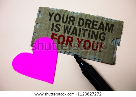 Text sign showing Your Dream Is Waiting For You. Conceptual photo Goal Objective Intention Target Yearning Plan Brown paperboard rough ideas message heart wild love lovely intentions. #1123827272