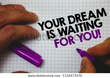 Text sign showing Your Dream Is Waiting For You. Conceptual photo Goal Objective Intention Target Yearning Plan Man hold holding purple marker notebook page messages intentions ideas. #1126473470