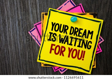 Text sign showing Your Dream Is Waiting For You. Conceptual photo Goal Objective Intention Target Yearning Plan Wooden background ideas messages intentions reflections communicate inform. #1126695611
