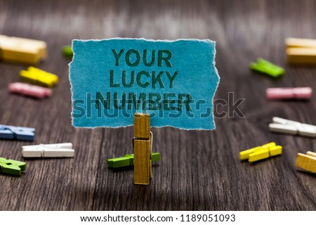 Text sign showing Your Lucky Number. Conceptual photo believing in letter Fortune Increase Chance Casino Clips symbol idea script notice board text capital cardboard design. #1189051093