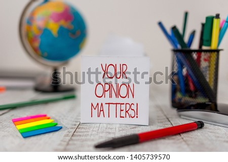 Text sign showing Your Opinion Matters. Conceptual photo show you do not agree with something that just been said Stationary and paper sheets plus small arrows with globe on the wooden desk.