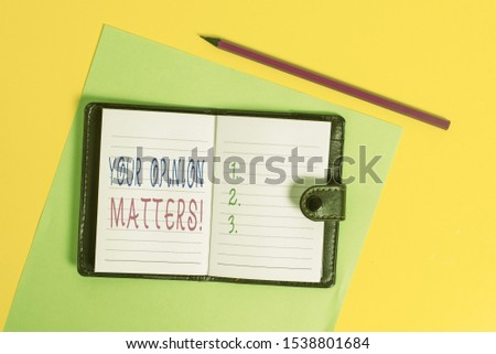 Text sign showing Your Opinion Matters. Conceptual photo show you do not agree with something that just been said Dark leather private locked diary striped sheets marker colored background.