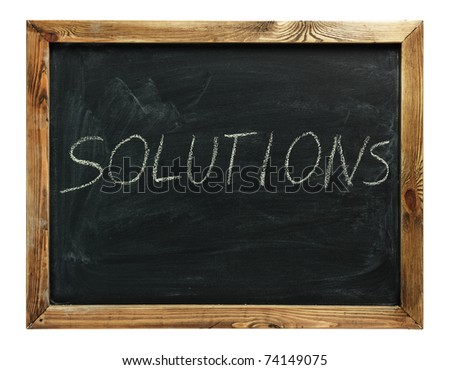 text solutions drawn on a chalkboard symbolizing ideas, inspiration and creativity
