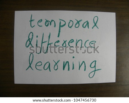 Text temporal difference learning hand written by green oil pastel on white color paper #1047456730