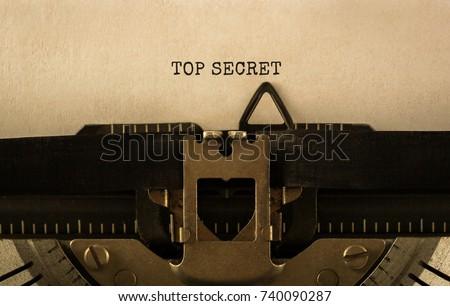 Text TOP SECRET typed on retro typewriter Stock photo ©