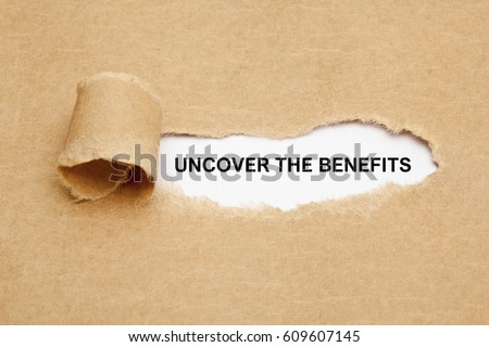 Text Uncover The Benefits appearing behind ripped brown paper.  Сток-фото ©