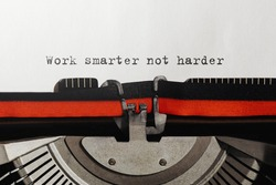 Text Work smarter not harder typed on retro typewriter