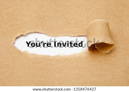 Text You Are Invited appearing behind torn brown paper. Invitation concept. #1358476427
