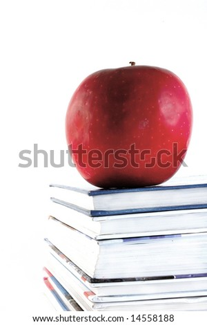textbooks with apple on white background