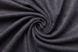 Textile and texture concept - close up of crumpled fabric background. Abstract background, dark grey colour. Top view