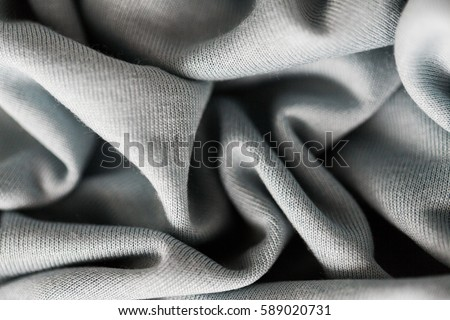 textile and texture concept - close up of crumpled gray cotton fabric background #589020731