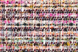 textile background - varicoloured woven yarns of boucle fabric close up
