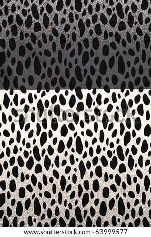 Textile background with split black and white cow pattern