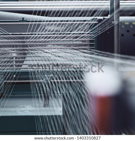 Textile factory machine weaving close up