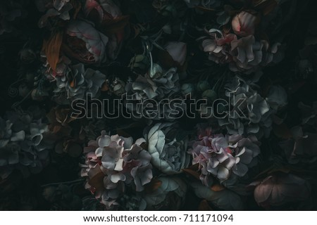 textile flowers in darkness