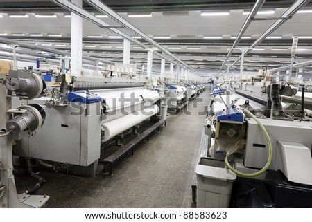 textile looms in a spinning and weaving factory, production hall in a yarn manufacturing factory