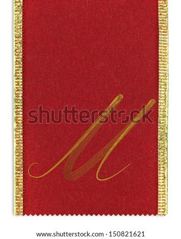 Textile monogram letter M on a ribbon