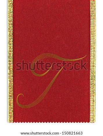 Textile monogram letter T on a ribbon