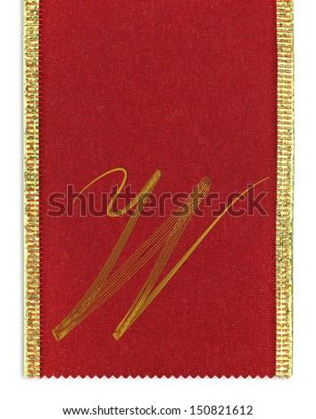 Textile monogram letter W on a ribbon