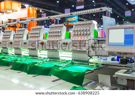 Shutterstock Textile - Professional and industrial embroidery machine. Machine embroidery is an embroidery process whereby a sewing machine or embroidery machine is used to create patterns on textiles.