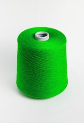 Textile reel on isolated white background. Bobbin of yarn on a white background. Side view.