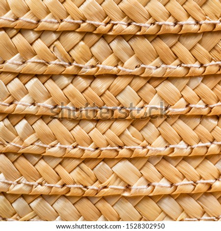 textile square background - texture of stitched summer straw hat from interwoven raffia fibers close up Photo stock ©