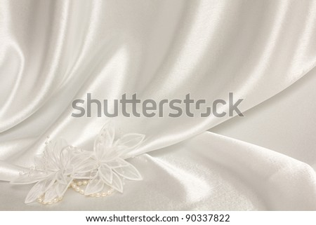 textile wedding background with pearls and flower from silk - stock photo
