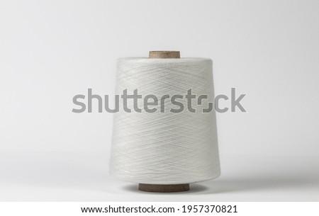 Textile white spool on isolated white background Foto stock ©