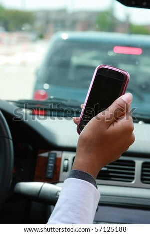 texting while driving - stock photo
