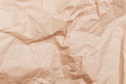 textural background. Rumpled brown cardboard paper texture