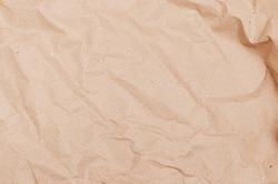 textural background. Rumpled brown cardboard paper texture
