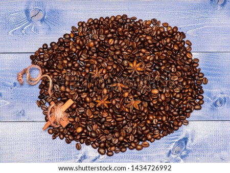Texture and background concept. Coffee shop or store. Degree of roasting coffee beans. Fresh roasted coffee beans. Coffee for inspiration and energy charge. Beverage with caffeine and spices.