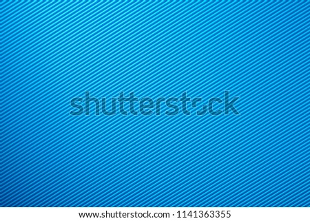 Texture and background from corrugated cardboard blue for decoration, for text design, for a template