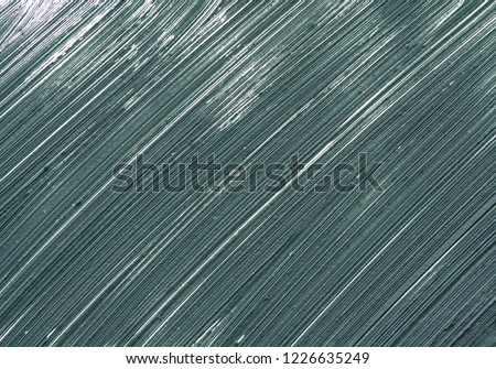 Texture and smear of dark green mascara for eyelashes isolated on white background
