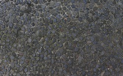 Texture background gravel floor. Cobbled surface with paving stones in different shades top view Natural stone pavement Exterior floor covering. Pathway. Photo concept. Ideal for design and for text.