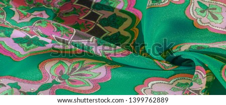 texture, background, multicolored silk fabric with a pattern of patterns on a green background, jacquard pattern #1399762889