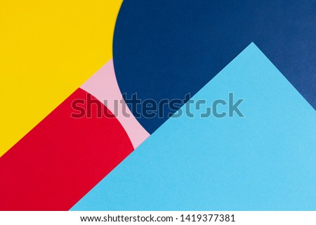 Texture background of fashion papers in memphis geometry style. Yellow, blue, light blue, red and pastel pink colors. Top view, flat lay