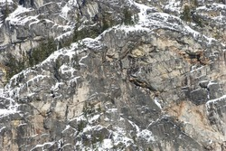 Texture Background of Mountain Rock Face with Snow and Icicles