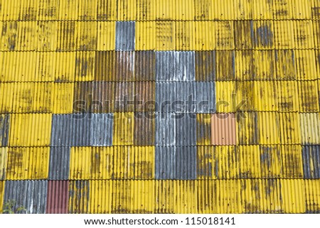 Texture background of yellow corrugated roof.