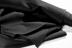 Texture. Background. Pattern. Black fabric for cutting clothes. Excellent evening dress, great design