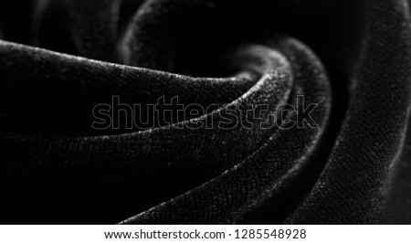 Texture background, pattern. Black Velveteen. This magnificent elastic velor fabric has a velvety nap. Pan pan adds shine and texture! It has a knitted back and is great for your design. #1285548928