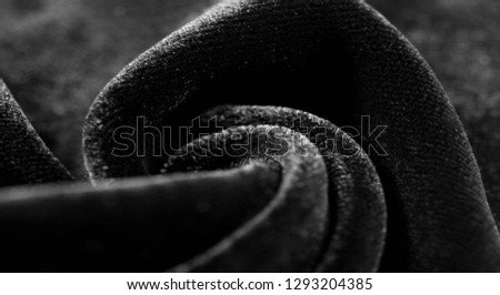 Texture background, pattern. Black Velveteen. This magnificent elastic velor fabric has a velvety nap. Pan pan adds shine and texture! It has a knitted back and is great for your design. #1293204385