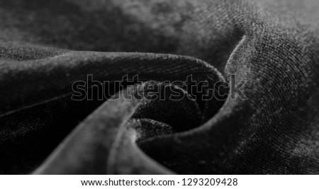 Texture background, pattern. Black Velveteen. This magnificent elastic velor fabric has a velvety nap. Pan pan adds shine and texture! It has a knitted back and is great for your design. #1293209428