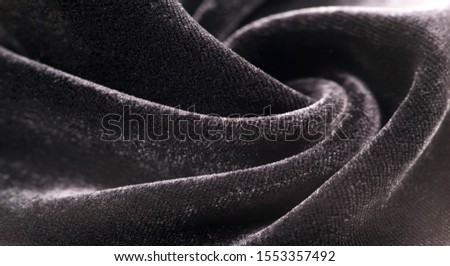 Texture background, pattern. Black Velveteen. This magnificent elastic velor fabric has a velvety nap. Pan pan adds shine and texture! It has a knitted back and is great for your design. #1553357492