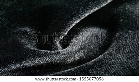 Texture background, pattern. Black Velveteen. This magnificent elastic velor fabric has a velvety nap. Pan pan adds shine and texture! It has a knitted back and is great for your design. #1555077056