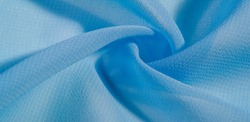texture background pattern. blue silk fabric This is a light artificial silk fabric of dupioni with a subtle matte sheen. It is perfect for your design, accents, wallpapers, posters and cards.