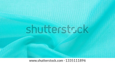 texture background pattern  blue silk fabric. this silk organza has a delicate open weave Use this luxurious fabric for anything from your design for special occasions to the creation of your projects #1335111896