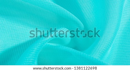 texture background pattern  blue silk fabric. this silk organza has a delicate open weave Use this luxurious fabric for anything from your design for special occasions to the creation of your projects #1381122698