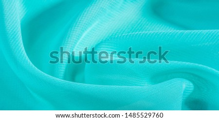 texture background pattern  blue silk fabric. this silk organza has a delicate open weave Use this luxurious fabric for anything from your design for special occasions to the creation of your projects #1485529760